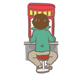 パチンコ台に向かって座っている男性のイラスト